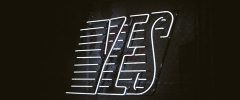 "White Neon ""Yes"" with lines on black background"